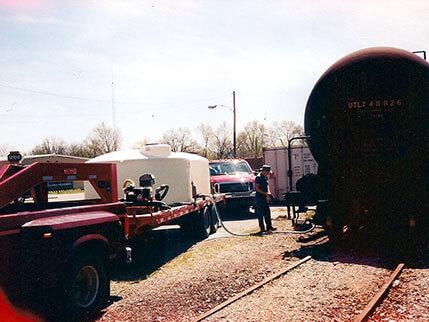 Freeman Ward unloading a railcar plantfood